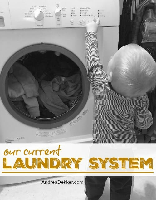 little boy helping with laundry