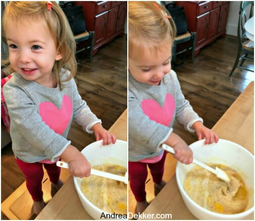 little girl helping to mix batter