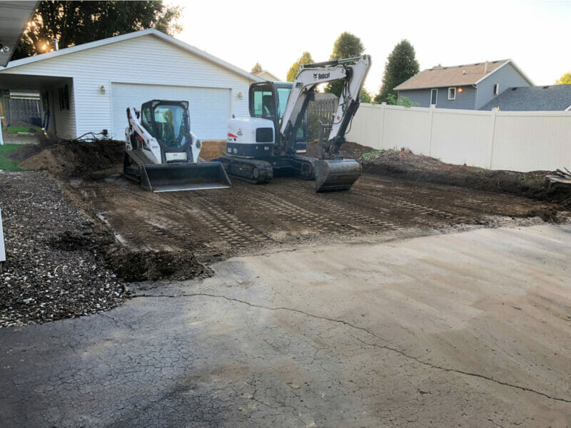 digging up the driveway for a pool